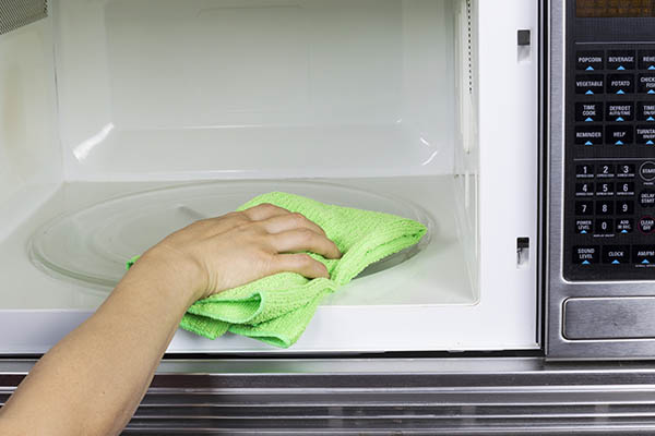 Someone Cleans Inside Microwave